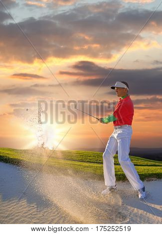 Man playing golf against colorful sunset during summer time stock photo