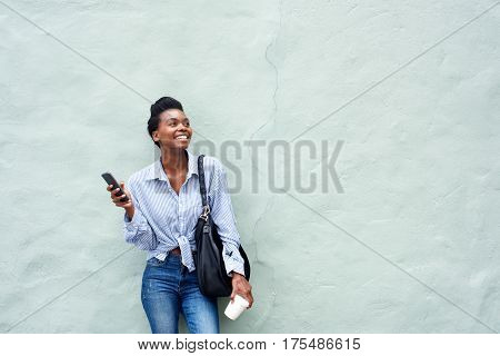Happy Black Woman Holding Mobile Phone
