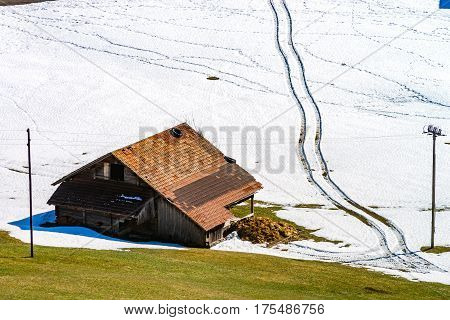 Natural landscape with lonely house in the snow. Alps. Switzerland stock photo