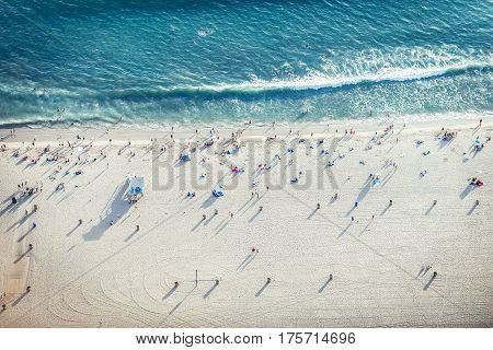 Santa Monica beach drone view - People sunbathing on the beach and swimming in the ocean stock photo