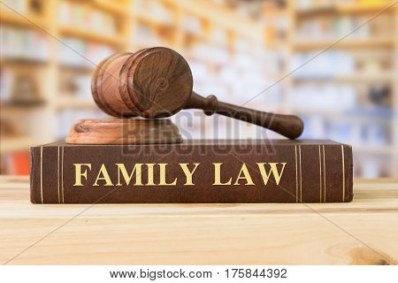 family Law books with a judges gavel on desk in the library. Law education law books family law concept. stock photo
