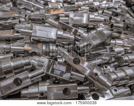Shiny aluminium cnc machined parts background with selective focus close up technique. stock photo