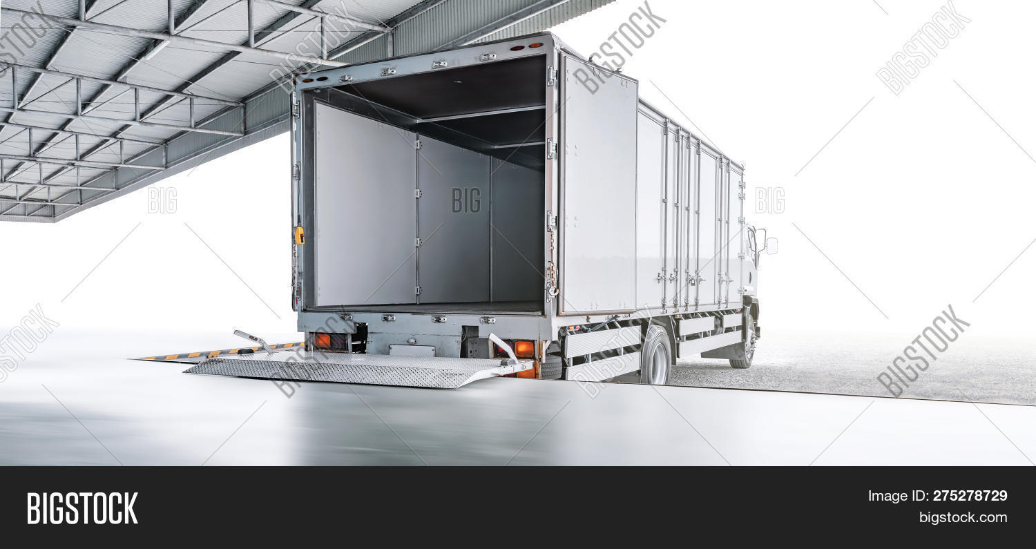 Transport Truck Waiting For Loading Export Merchandise At Industrial Warehouse, Transportation Or Lo
