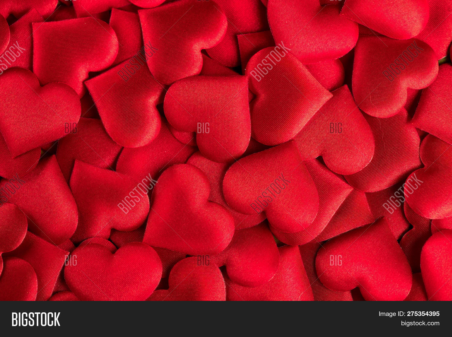 Valentine's Day Background. Holiday Abstract Valentine Background with red satin Hearts. Heart Shape