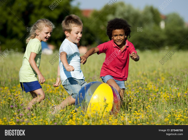 4-5,african,african children,american,ball,blond,boys,brown,caucasian,cheerful,child,childhood,children playing,colorful,descent,ethnicity,flowers,friendship,fun,girls,group,group of children,hair,happiness,happy child,happy children,hispanic,horizontal,latin,little,meadow,motion,multi-ethnic,multi ethnic group,non-urban,outdoors,park,people,playful,playground,playing,preschool children,preschooler,running,scene,spring,summer,three,togetherness,variation,vitality,years,yellow