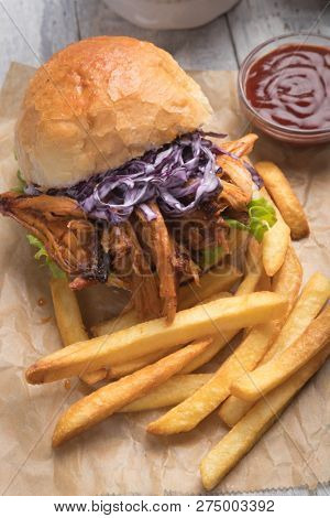 Burger with pulled pork, classic american meat sandwich stock photo