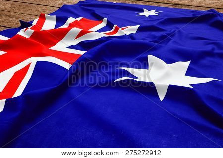 Flag of Heard Island And Mcdonald Islands on a wooden desk background. Silk flag top view. stock photo