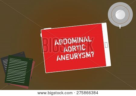 Handwriting text writing Abdominal Aortic Aneurysmquestion. Concept meaning getting to know the enlargement of aorta Tablet Empty Screen Cup Saucer and Filler Sheets on Blank Color Background. stock photo