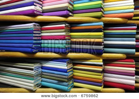 Manz colorful fabrics on sale at a fabric store stock photo