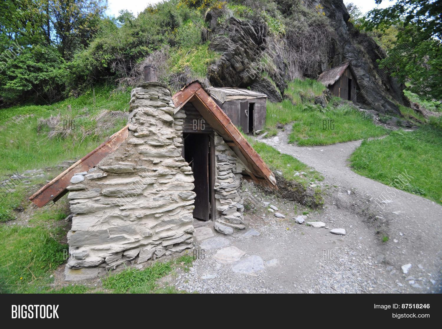 Arrowtown near Queenstown Otago New Zealand is the best example of a goldrush era miners settlement These Chinese gold diggers arrived during the 1860's gold rush. They made and lived in these primitive huts. ** Note: Soft Focus at 100%, best at smaller