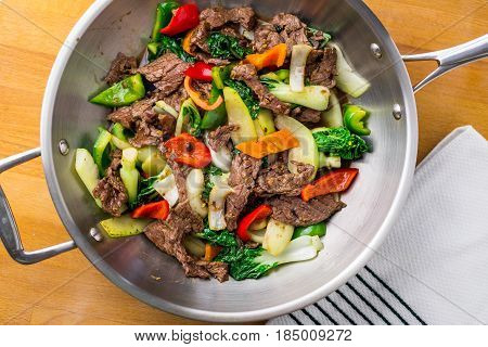 Beef Stir Fry from above. Healthy vegetable & beef stir-fry. Made with flank steak peppers onions and bok choy stir fried in an asian wok. stock photo