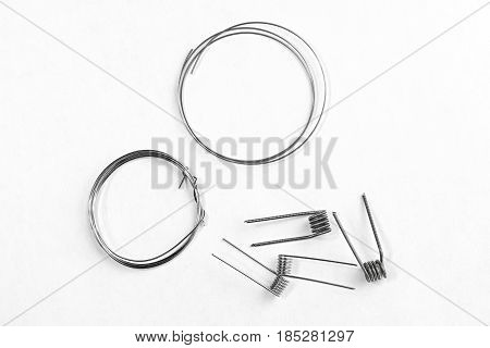 A simple Clapton coil four pieces and two wires on a white background isolated stock photo