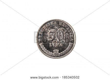 Old used and worn out 50 lipa coin. Coin of croatian currency for 05 kuna isolated on white. High resolution picture. stock photo