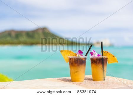 Hawaii mai tai drinks on waikiki beach bar travel vacation in Honolulu, Hawaii. Famous hawaiian drin