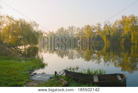 Front of a small boat with the sky reflected in a river in the Amazon rain forest in Peru stock photo