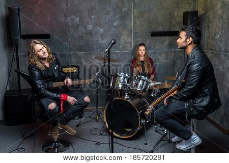 rock band resting after rehearse in studio band on stage concept