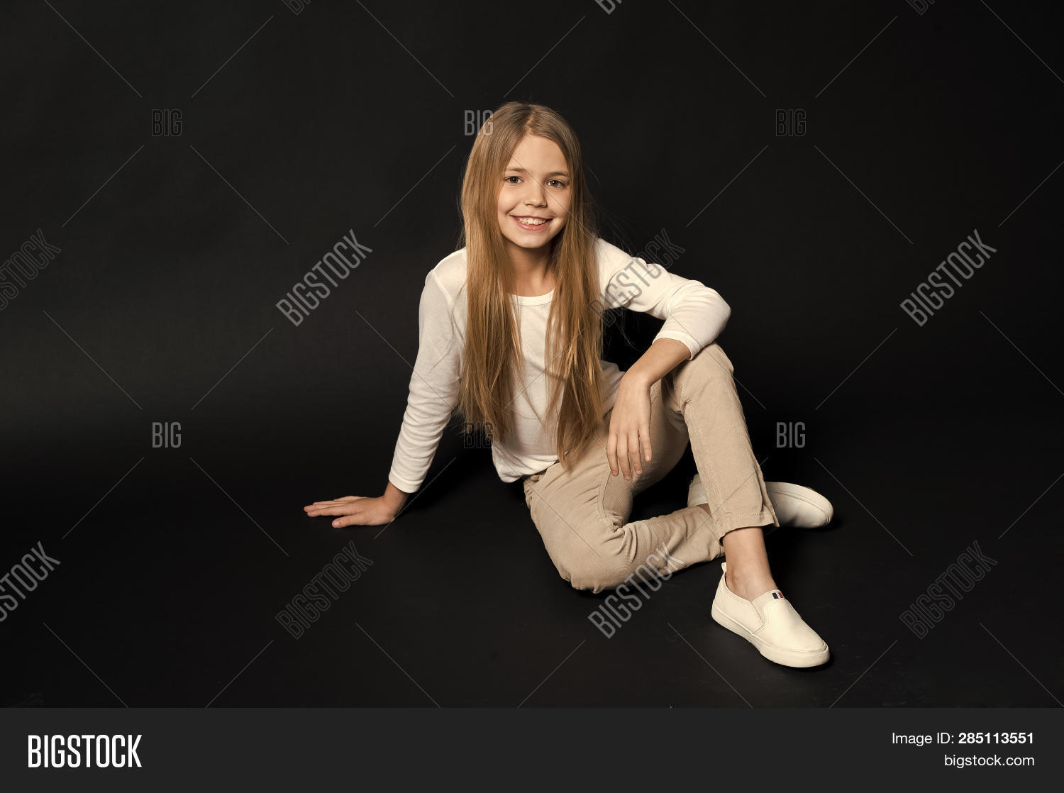 Carefree Childhood. Girl Long Hair Cute Smiling Face Relaxing, Black Background. Child Girl Carefree
