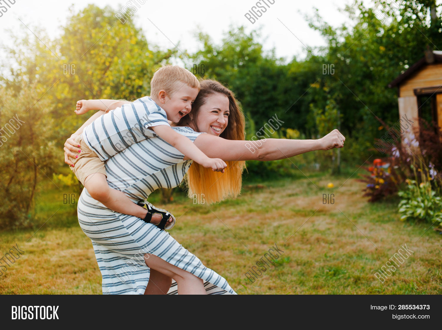 baby,beautiful,boy,child,childhood,cute,day,emotional,enjoy,family,female,flower,fun,green,hands,happiness,happy,high,holding,human,joy,kid,laughing,life,lift,little,love,mom,mother,motherhood,nature,outdoor,outside,parent,park,people,playing,smile,smiling,son,spring,summer,sun,sunny,toddler,together,up,woman,young