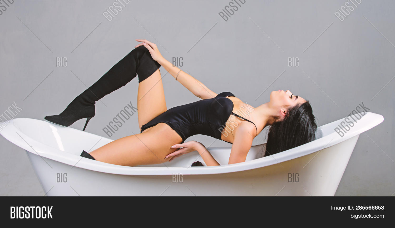 Girl Relaxed Sexy Pose Lean On Bathtub. Woman Sexy Girl Long Legs Wear Tight Bustier Bodysuit And Hi