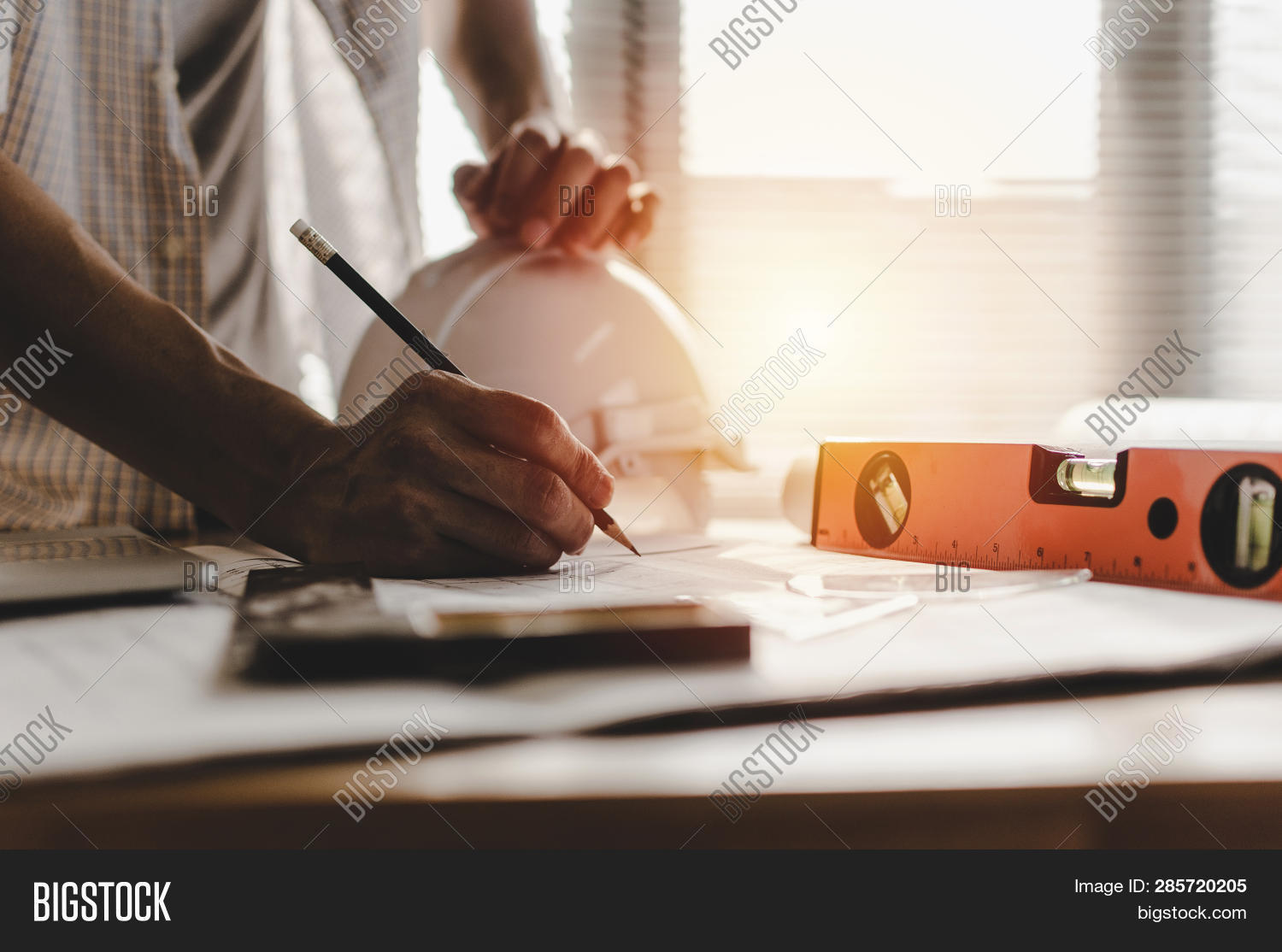 Hand Professional Architect, Engineer Or Interior Hands Drawing With Blueprint On Workplace Desk In