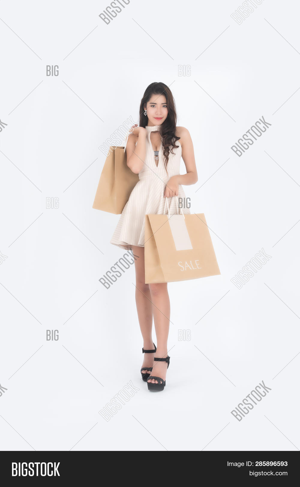 Woman hold shopping bag, Asian girl, 20-30 years old,on white background.