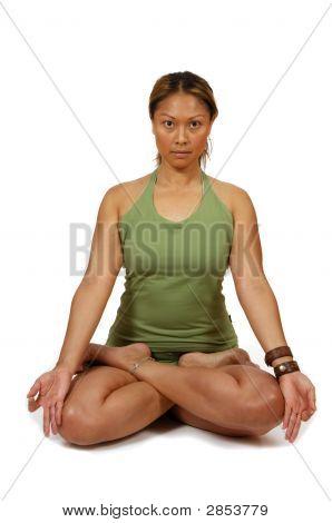 Woman in meditative hatha yoga lotus pose stock photo
