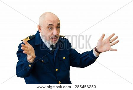 elderly man in an officer's sea uniform emotionally narrates something, emotionally gesticulating, isolated on white background stock photo