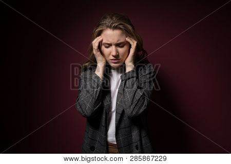 Health And Pain. Stressed Exhausted Young Woman Having Strong Tension Headache. Closeup Portrait Of Beautiful Sick Girl Suffering From Head Migraine, Feeling Pressure And Stress. stock photo