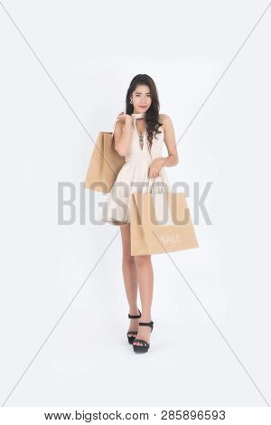 Woman hold shopping bag, Asian girl, 20-30 years old,on white background. stock photo