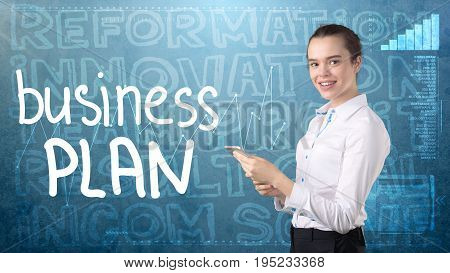Beauty businesswoman in suit on painted background with marketing words. Advertising and business plan concept. stock photo
