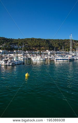 Vertical view of Boats and marina in L'Estartit city on the Costa Brava under blue sky stock photo