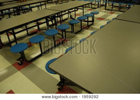 View of school cafeteria tables and tile floor stock photo