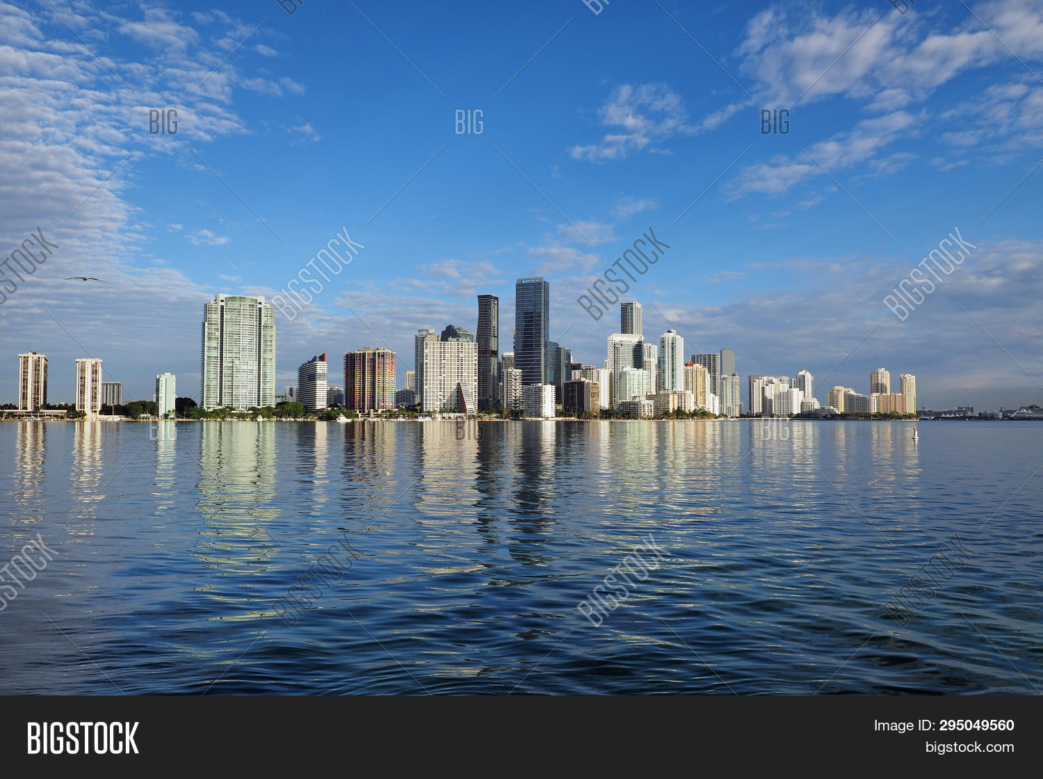 Miami, Florida 11-24-2018 The Skyline Of The City Of Miami, Florida, Reflected In The Calm Water Of