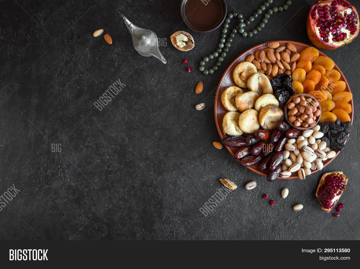 Islam,Muslim,almonds,apricots,arabic,background,beads,bishvat,black,coffee,copy,dates,dessert,dried,dry,eastern,fasting,figs,food,fruit,hazelnuts,holidays,iftar,ifthar,judaic,kareem,latern,middle,natural,nut,nutrient,oil,organic,pistachios,prunes,quranic,raisins,ramadan,ripe,rosary,rustic,snack,space,sweet,traditional,turkish,vegetarian