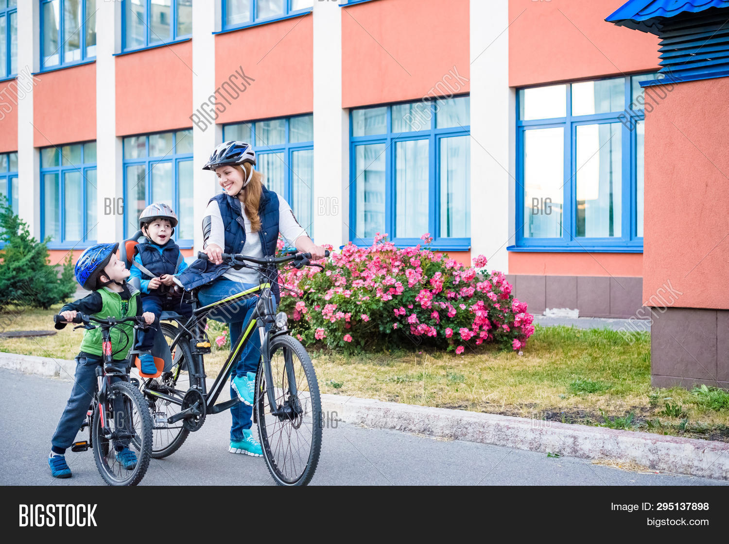 Family Cycling, Mother With Happy Kid Riding Bike Outdoors. Happy Active Sport Leisure. Family Are B