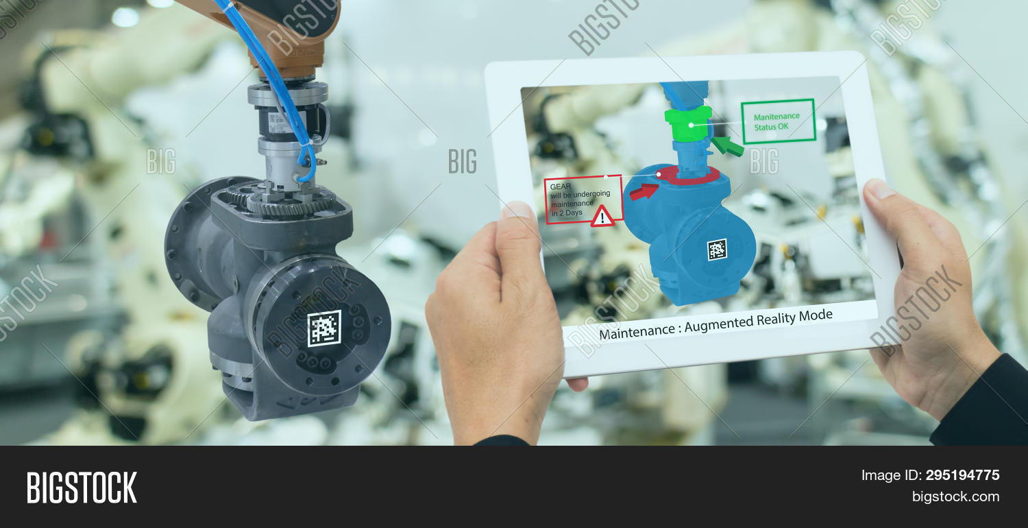 Iot Industry 4.0 Concept,industrial Engineer Using Smart Tablet With Augmented Mixed With Virtual Re