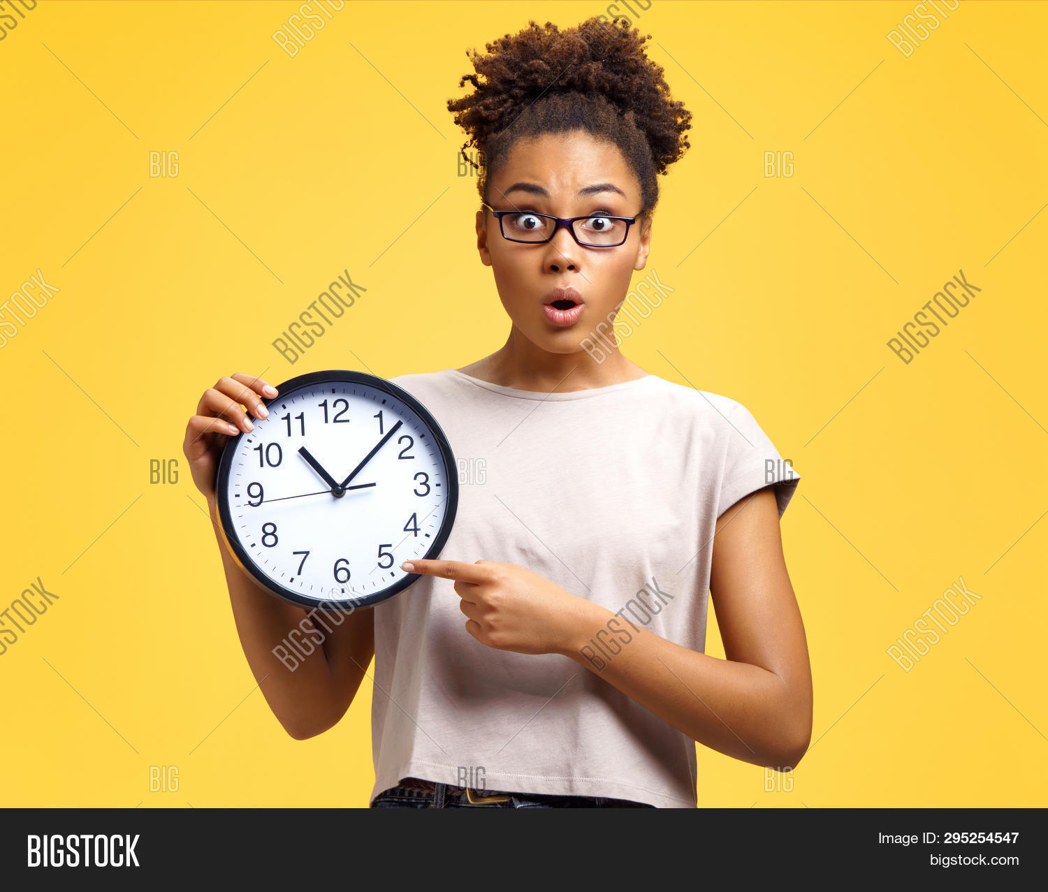 afro,alarm,astonished,attractive,background,beauty,casual,clock,colorful,concept,curly,demonstrates,emotional,enjoying,expressions,eyes,face,facial,female,forefinger,gaze,gesture,girl,glad,hair,hands,happy,hold,image,latin,looking,model,open,outfit,punctuality,shirt,shock,skinned,spanish,student,surprised,teenager,time,woman,work,worker,yellow,young