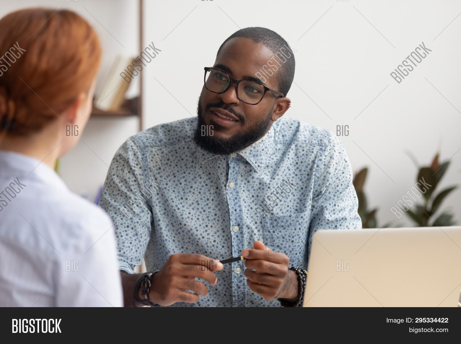 African Hr Manager Listening To Caucasian Applicant At Job Interview