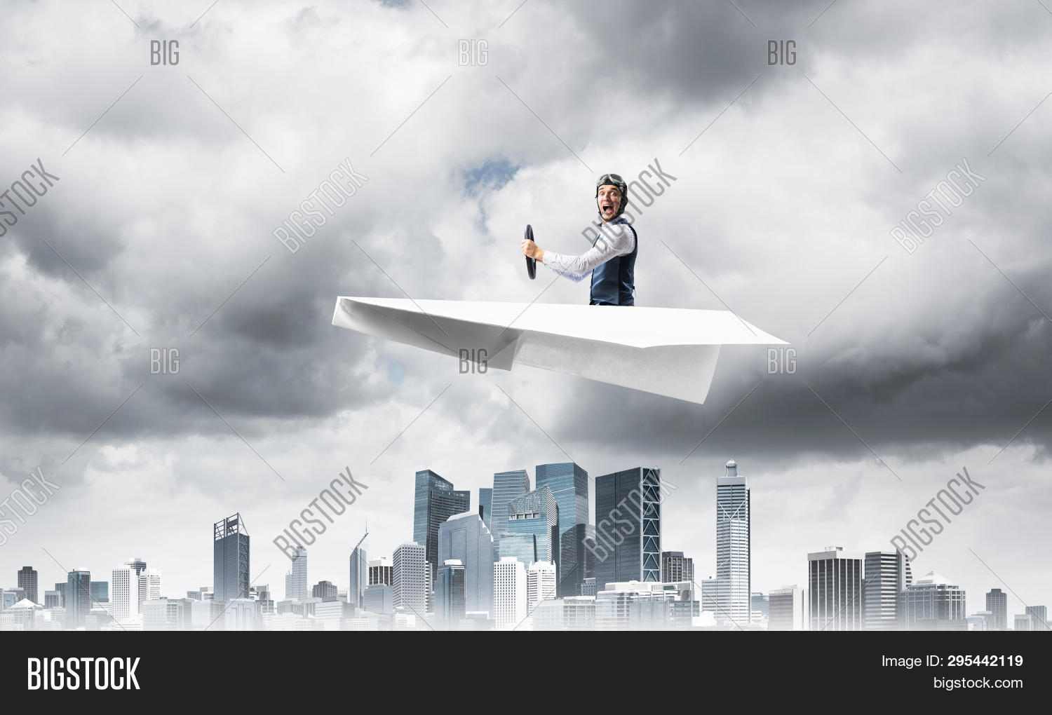 aerial,air,aircraft,airplane,aviator,building,business,businessman,cloudscape,concept,course,crisis,dark,direction,downtown,dramatic,driving,fly,funny,goggles,hat,helmet,hurricane,leader,leadership,leather,man,management,media,megalopolis,metropolis,motivation,outdoors,panorama,paper,people,person,pilot,plane,risk,sky,skyscape,skyscraper,small,storm,urban