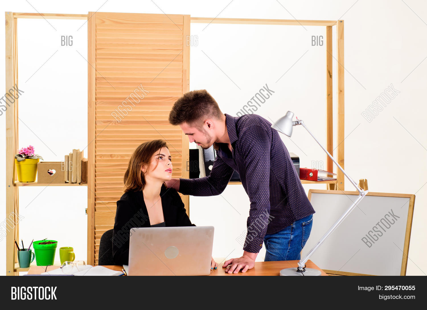 Falling In Love In Office. Workplace Romance Of Handsome Man And Sexy Woman In Office. Couple In Lov
