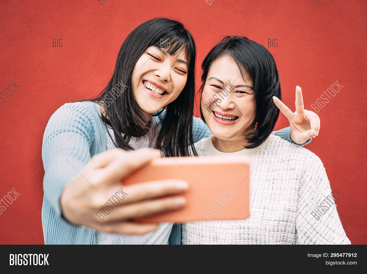 Asian Mother And Daughter Taking Photo Selfie With Mobile Smartphone Outdoor - Happy Chinese Family