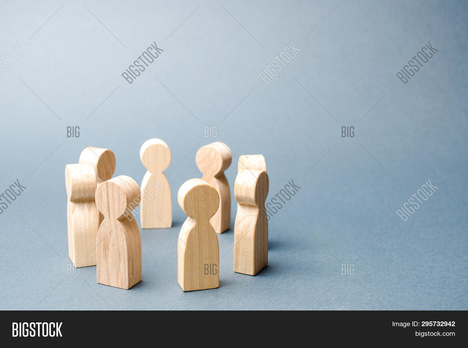 People Stand In A Circle On A Gray Background. Wooden Figures Of People. A Circle Of People. Discuss