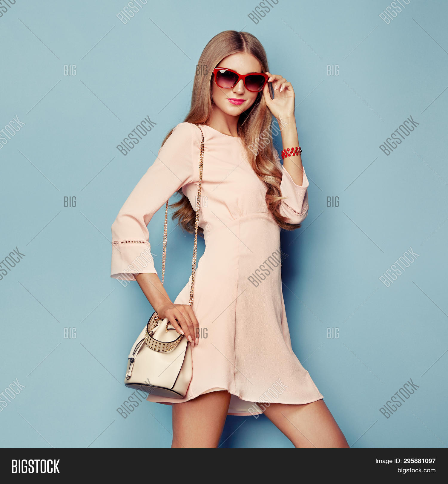 Portrait Of Fashion Young Woman In Pink Dress. Lady In Stylish Coral Summer Outfit. Girl Posing On A