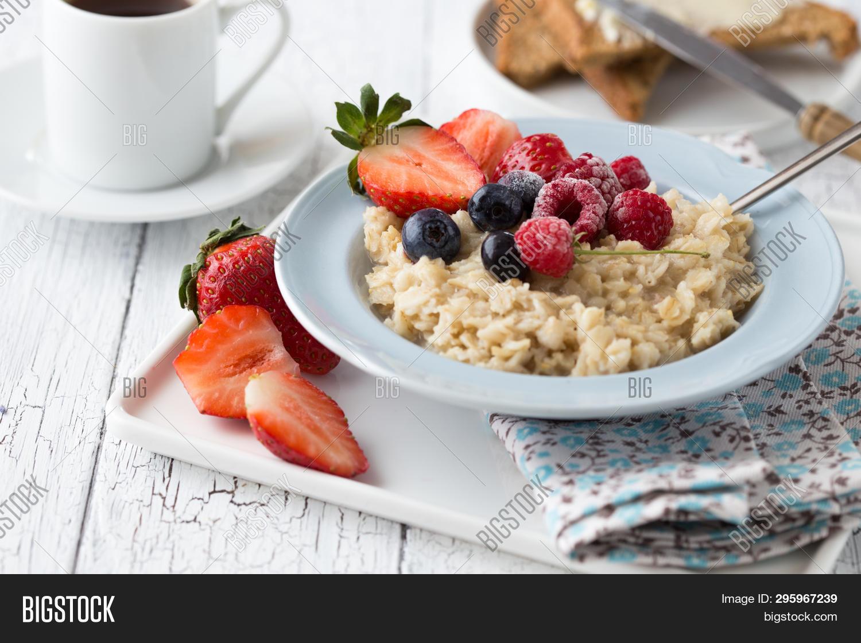 background,banana,berry,bowl,breakfast,cereal,coffee,concept,cup,dairy,dessert,diet,dietary,dieting,eating,flakes,flat,food,fresh,fruit,grain,granola,healthy,homemade,kids,lay,meal,morning,muesli,oat,oatmeal,organic,porridge,recipe,red,refreshment,ripe,rustic,snack,spoon,strawberries,superfood,sweet,table,top,vegan,vegetarian,view,white,wooden