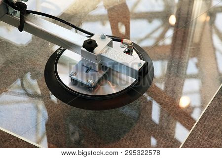 Vacuum sucker for glass. Application in real conditions stock photo