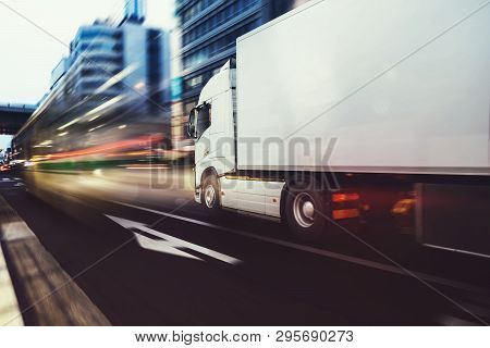 White truck moving fast on the road in a modern city with light effect stock photo