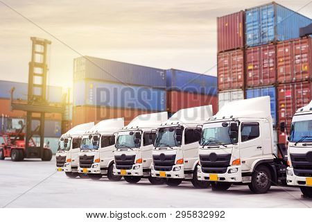 New truck fleet with container depot as for shipping and logistics transportation industry. stock photo