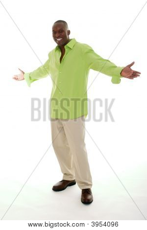 Casual young African American man standing in a bright green shirt with a welcoming hands apart gesture. stock photo