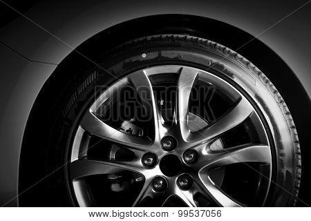 Close-up of aluminium rim of luxury car wheel. Detail background stock photo