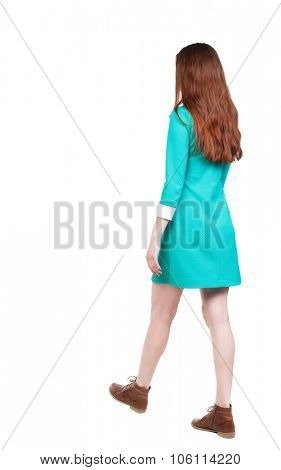 side view of walking  woman in dress. beautiful girl in motion.  backside view of person.  Rear view